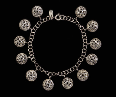 Silver lattice bead charm bracelet.