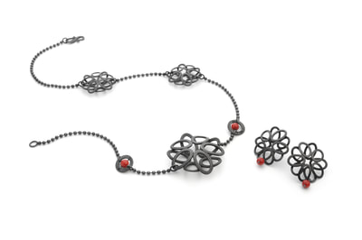 Assymetric oxidised necklace and earrings with bamboo coral.