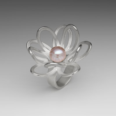 Silver lotus flower ring with pink pearl.