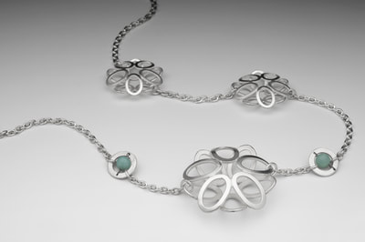 Assymetric silver necklace with apatite beads.